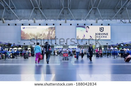 BEIJING-OCT. 4, 2014. Beijing Capital Airport Terminal 2 interior. As of 2012, it is the second busiest airport in the world in terms of passenger throughput behind US Hartsfield-Jackson Atlanta.   - stock photo