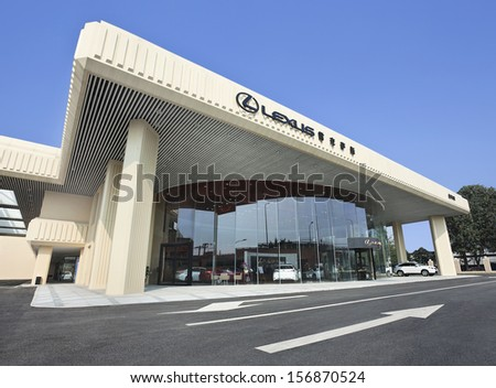 BEIJING-OCT. 3. Lexus dealer. Toyota may start producing Lexus cars in China in 2015 or 2016, when annual sales will likely reach 100,000, according to auto analyst Kota Yuzawa. Beijing, Oct. 3, 2013. - stock photo