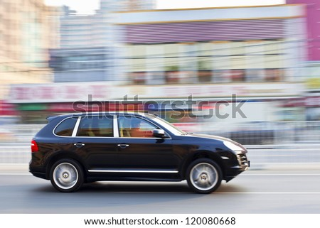 BEIJING-OCT. 28: Rushing Porsche Cayenne. Porsche may deliver more cars in China than in its German home market by 2011, according the Jebsen Group, Porsche dealer on Oct. 28, 2011 in Beijing. - stock photo