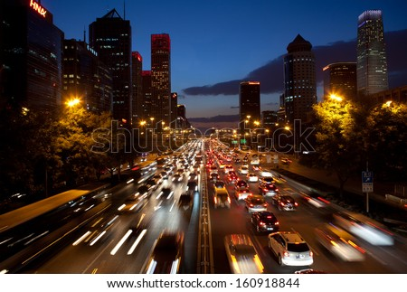 BEIJING-OCT19: Traffic jam in Beijing's CBD on Oct 19,2013 in Beijing, China. Vehicle exhaust fumes are among Beijing's top sources of air pollution, contributing 22.2%of PM 2.5 particles in the city - stock photo