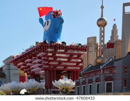BEIJING - OCTOBER 3: Shanghai World Expo 2010 mascot Haibao and replicas of Shanghai landmarks are on display during China's 60th anniversary at Tiananmen Square on October 3, 2009, in Beijing, China. - stock photo