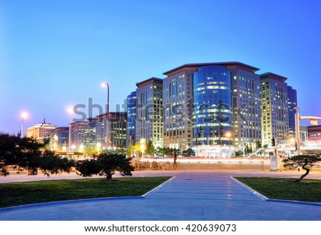 Beijing Oriental Plaza buildings at night, transport and ordinary urban life of the city.
