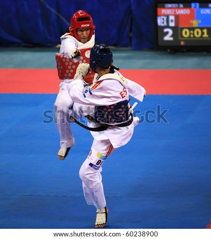 BEIJING-SEP 02:Guillermo Perez of Mexico(L) fights against Joel Gonzalez Bonilla of Spain(R) during the Taekwondo competitions of the SportAccord Combat Games 2010 on Sep 02,2010 in Beijing,China - stock photo