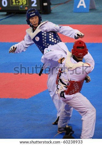 BEIJING-SEP 02:Leonardo Basile of Italy (R) fights against Arman Chilmanov of Kazakhstan (L) during the Taekwondo competitions of the SportAccord Combat Games 2010 on Sep 02,2010 in Beijing,China - stock photo
