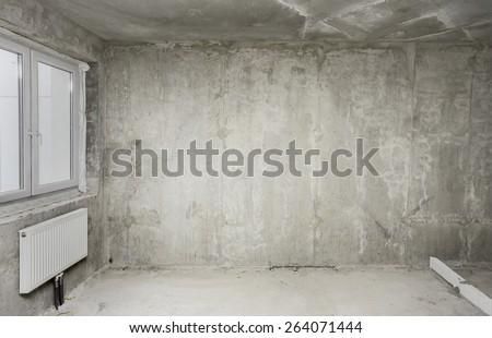 Being renovated house, apartment, radiator, window - stock photo