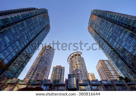 Being surrounded by glass buildings - stock photo