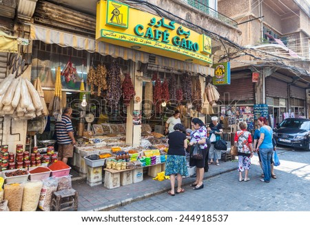 BEIRUT, LEBANON - JUNE 17, 2013: An unidentified locals buying food on a street. Life in Beirut is coming back to normal after Lebanon war in 2006.