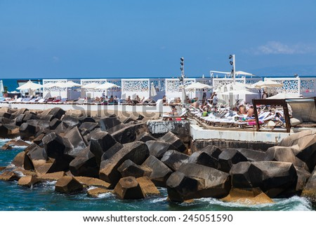 BEIRUT, LEBANON - JUNE 16, 2013: An unidentified locals relaxing on the beach around quay. Life in Beirut is coming back to normal after Lebanon war in 2006. - stock photo