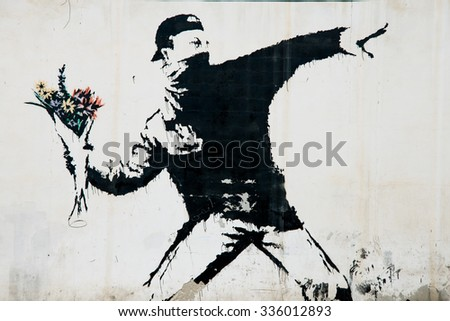 BEIT SAHOUR, OCCUPIED PALESTINIAN TERRITORIES - JUNE 18: A mural by the British street artist Banksy covers a wall in the West Bank village of Beit Sahour, June 18, 2014.