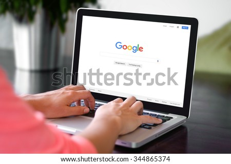 BEKASI, INDONESIA - NOVEMBER 29, 2015: A woman is typing on Google search engine from a laptop. Google is the biggest Internet search engine in the world. - stock photo