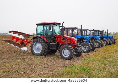 Belarus, Bobruisk district, September 9: are small tractors lined up on the field, September 9, 2015 in Bobruisk district, Belarus.