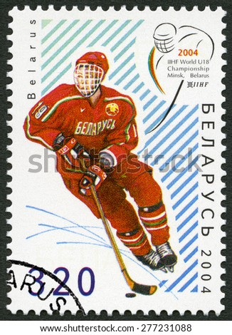BELARUS - CIRCA 2004: A stamp printed in Belarus shows Ice Hockey player, dedicated 18rd  Junior Ice Hockey World Championship IIHF in Belarus, circa 2004 - stock photo