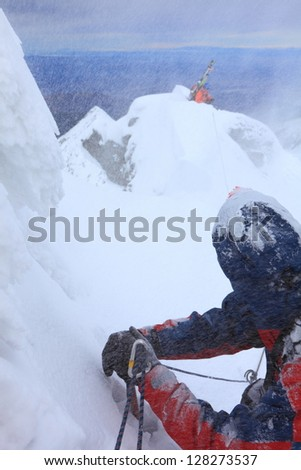 Belaying the lead while descending a steep narrow ridge in bad weather
