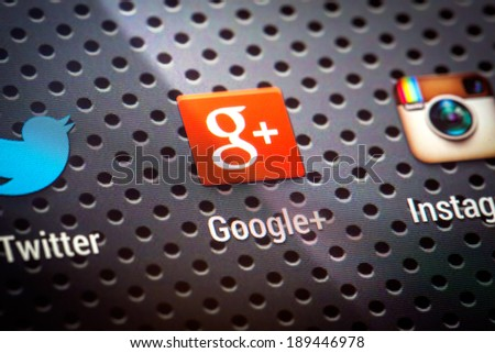 BELCHATOW, POLAND - APRIL 10, 2014: Closeup photo of Google Plus icon on mobile phone screen. Popular social network. - stock photo