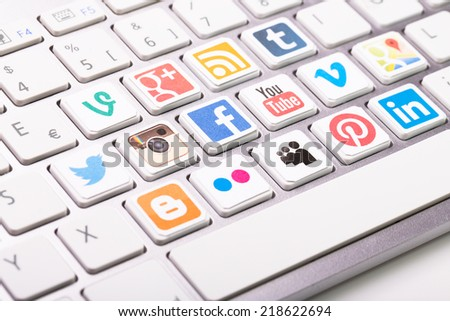 BELCHATOW, POLAND - AUGUST 31, 2014: A social media logotype collection printed and placed on modern computer keyboard. - stock photo