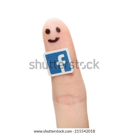 BELCHATOW, POLAND - AUGUST 31, 2014: Facebook logo printed on paper and stuck to the finger. - stock photo