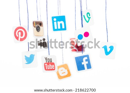 BELCHATOW, POLAND - AUGUST 31, 2014: Popular social media website logos printed on paper and hanging on strings. - stock photo