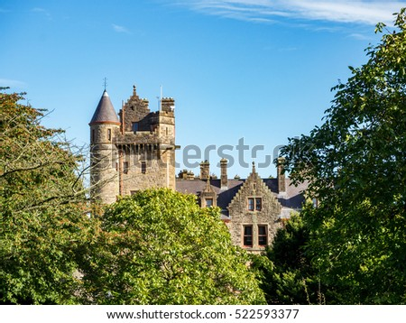 Belfast castle among trees. Tourist attraction on the slopes of Cavehill Country Park in Belfast, Northern Ireland