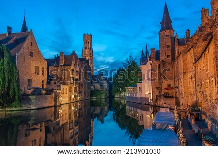 Belfort and the canals of Brugge in the evening - stock photo