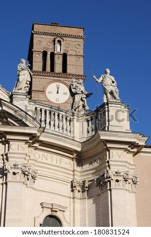 Belfry and statues on top of Holy Cross in Jerusalem Basilica in Rome, Italy