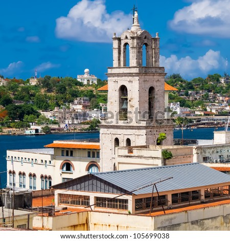 Belfry of the church of San Francisco, a landmark of Old Havana with the bay on the background - stock photo
