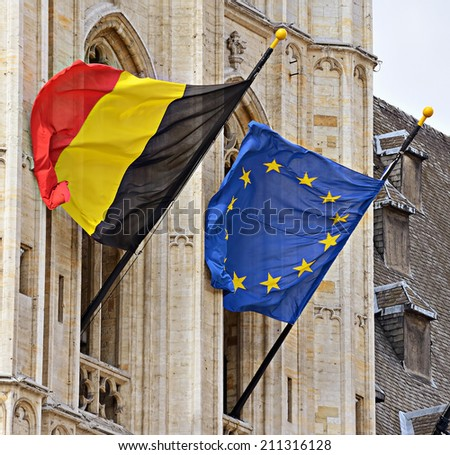 Belgian and European Union flags on city hall in Brussels, Belgium - stock photo