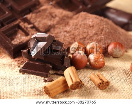 belgian chocolate bars, nuts and cocoa powder - stock photo