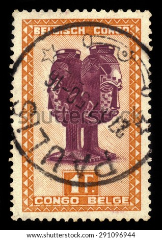 BELGIAN CONGO - CIRCA 1947: A stamp printed in Belgian Congo shows Mbuta sacred double cup carved with faces of man and woman, circa 1947 - stock photo