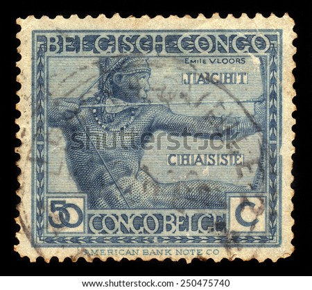 BELGIAN CONGO - CIRCA 1923: A stamp printed in Belgian Congo shows portrait of archer using a hunting bow, circa 1923 - stock photo