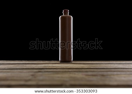 Belgian Gin Bottle in terracotta, black background