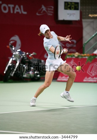 Belgian tennis star Justine Henink in action against Alicia Molik at the Qatar Total Open, Doha, February 28, 2007, which Henin won. - stock photo