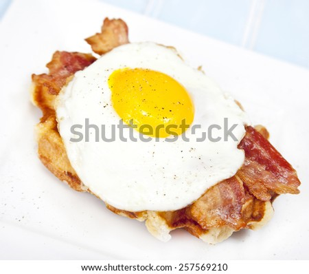 Belgian Waffle with bacon and fried egg - stock photo