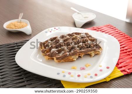 Belgian waffle with chocolate cream. Selective focus, narrow depth of field - stock photo