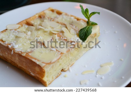 Belgian waffle with cream, coconut and mint