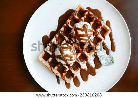 Belgian waffle with ice cream, chocolate and mint - stock photo