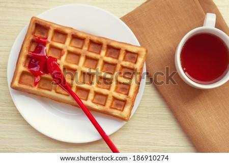 Belgian waffles for breakfast or tea time - stock photo