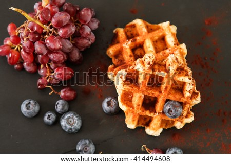 Belgian waffles with blueberries and grapes Breakfast. Flat Lay. Top view. - stock photo