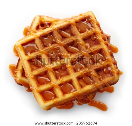 Belgian waffles with caramel sauce isolated on white background (top view) - stock photo