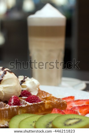 Belgian waffles with ice cream, chocolate and strawberries