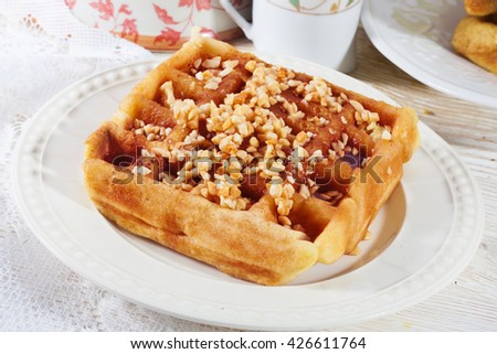 Belgian waffles with nuts closeup honey syrup Polish Czech - stock photo