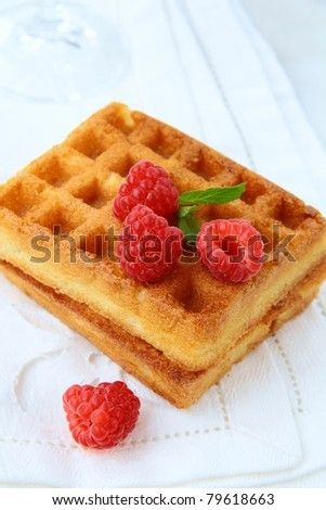 Belgian waffles with raspberries on a vintage napkin