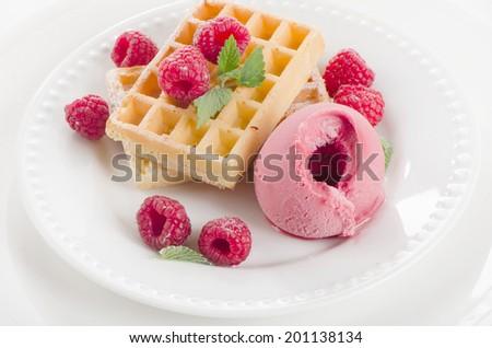 Belgian waffles with raspberries sorbet. Selective focus - stock photo