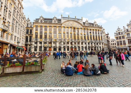 BELGIUM, BRUSSELS - MAY 16, 2015: Grand Place in Brussels with unidentified people. The square is the most important tourist destination and memorable landmark in Brussels - stock photo