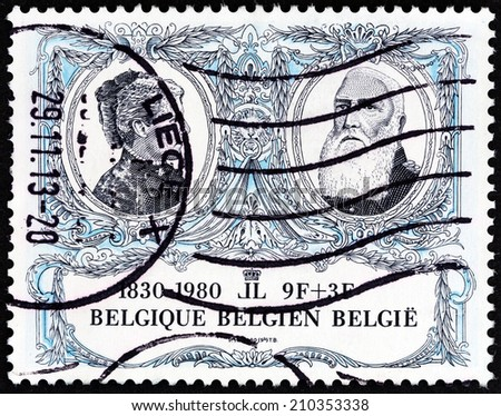 """BELGIUM - CIRCA 1980: A stamp printed in Belgium from the """"150th anniversary of Belgian Independence """" 2nd issue shows King Leopold II and Queen Marie Henriette, circa 1980.  - stock photo"""