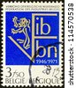 BELGIUM - CIRCA 1971: A stamp printed in Belgium issued for the 25th anniversary of Federation of Belgian Industries shows F.I.B./V.B.N. emblem, circa 1971. - stock photo