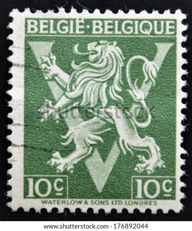 BELGIUM - CIRCA 1946: A stamp printed in Belgium shows The coat of arms of the Kingdom of Belgium bears a lion or Leo Belgium, circa 1946