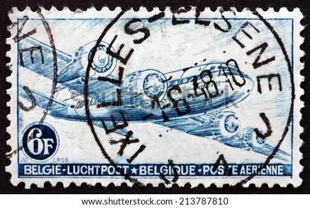 BELGIUM - CIRCA 1946: a stamp printed in the Belgium shows DC-4 Skymaster, Sabena Airline, circa 1946 - stock photo