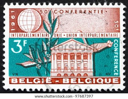 BELGIUM - CIRCA 1961: a stamp printed in the Belgium shows Senate Building, Brussels, Laurel and Sword, Belgium, circa 1961 - stock photo
