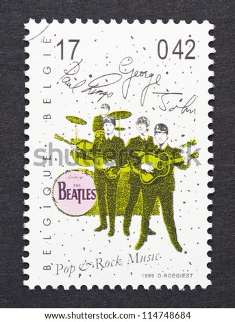 BELGIUM -Â?Â? CIRCA 1999: postage stamp printed in Belgium showing an image of The Beatles, circa 1999. - stock photo