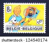 BELGIUM � CIRCA 1979: postage stamp printed in Belgium showing an image of Tintin with his dog Snowy and captain Haddock, circa 1979. - stock photo